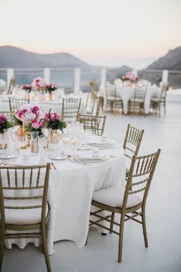 Intimate & Luxurious Cliffside Santorini Wedding   Stella and Moscha   Nikos Gogas 27