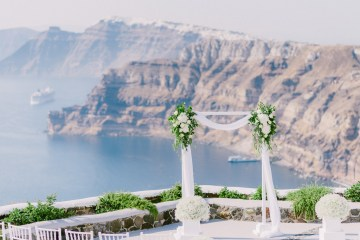Classy Santorini Destination Wedding (With Amazing Caldera Views!) | Elias Kordelakos 40