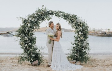 Bohemian Greek Fairytale Wedding Featuring A Floral Ceremony Arch