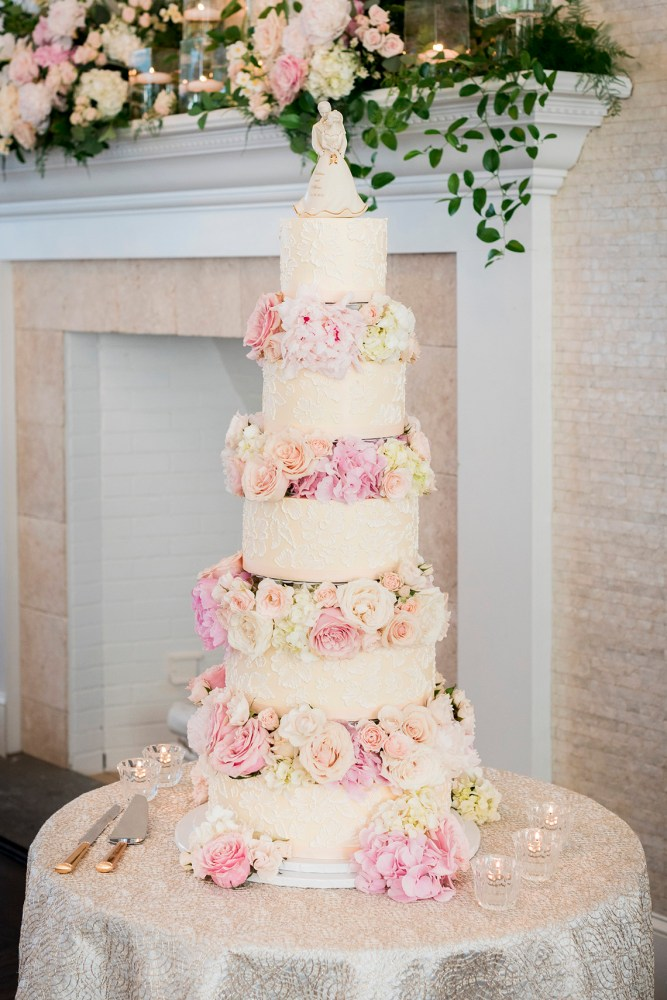 Tall Tiered Lace Wedding Cake with Layers of Roses