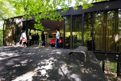 """This Oct. 4, 2009 photo shows visitors touring the pavilion in the back of the modernist home in Highland Park, Ill., that was featured in the movie """"Ferris Bueller's Day Off."""" The home, where Ferris Bueller's friend Cameron famously """"killed"""" his father's prized Ferrari, sold Thursday, May 29, 2014 for $1.06 million. The house, built in 1953 by Mies van der Rohe-protege A. James Speyer, was first put on the market in 2009 listed at $2.3 million. (AP Photo/Sun-Times Media, Eric Davis) MANDATORY CREDIT, MAGS OUT, NO SALES"""