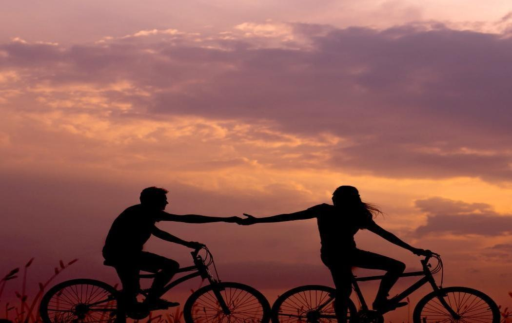 A couple riding on bicycles