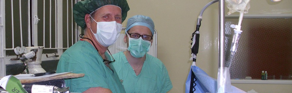 Dr. Scott Silverberg administering anesthesia in Zambian Operating Room while son Joshua observes.