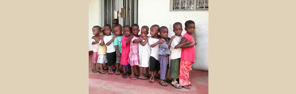 Showing off our new shoes at Bridge for Peace Childrens Village Uganda