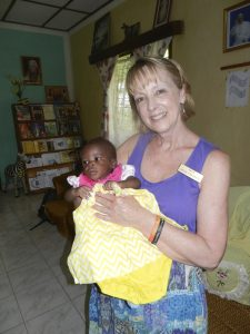 Woman holding a little baby girl.