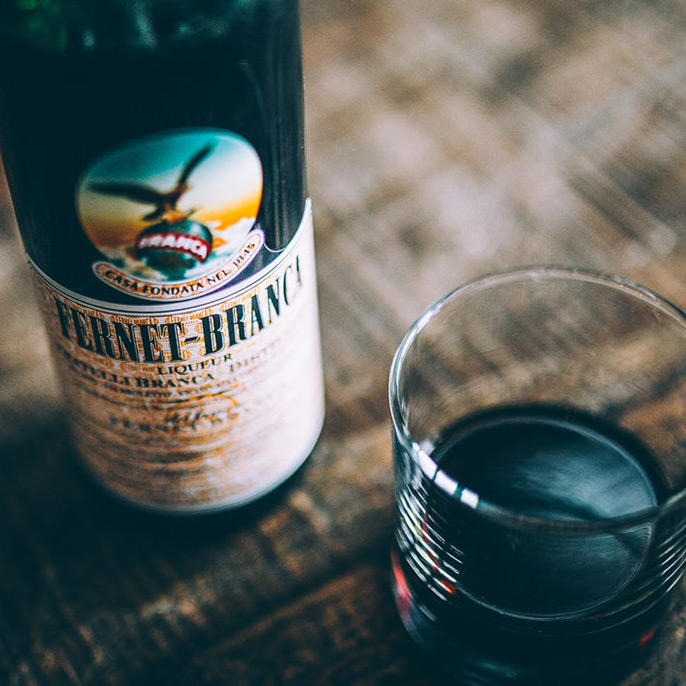 bartenders handshake the cult of fernetbranca with cocktail recipes and lore
