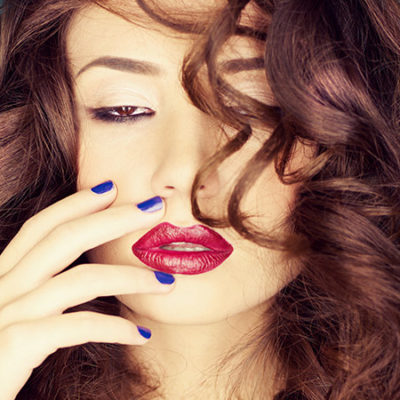 woman with red lipstick and curly hair
