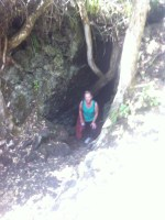 Debbie emerges from one of the lava caves