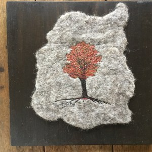 Felted thread art by Bridget O'Flaherty Maple tree on natural wool felt mounted on a pine board
