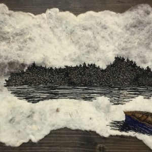 Free motion embroidery of a blue canoe on a lake on a Felted background
