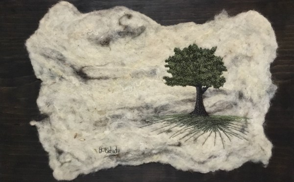 Free motion embroidery on maple tree on felted background