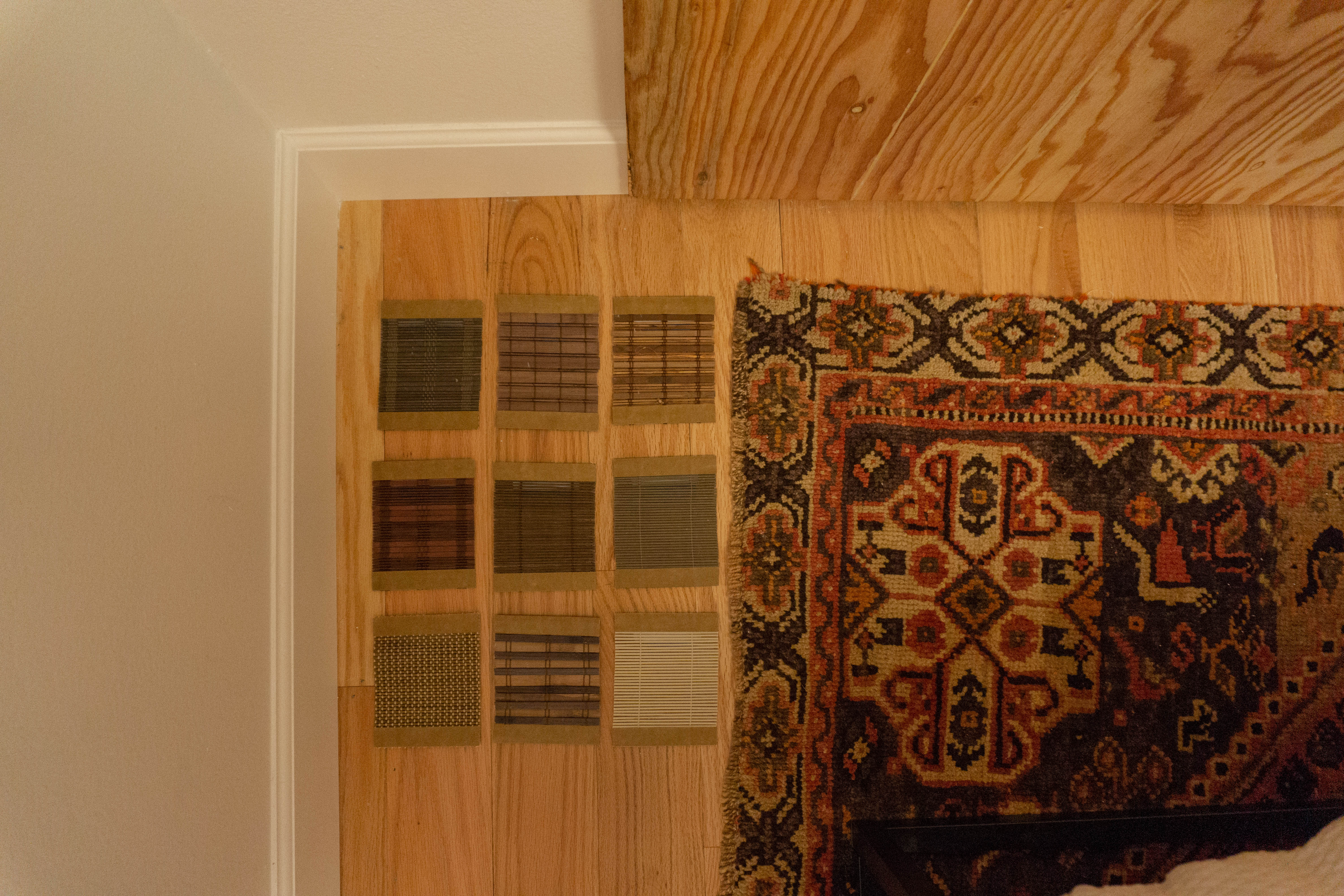 Woven Wood Shade Samples on Floor next to Rug