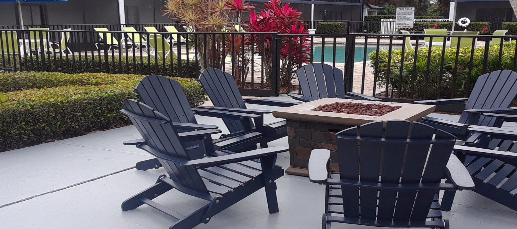conversation area poolside with firepit