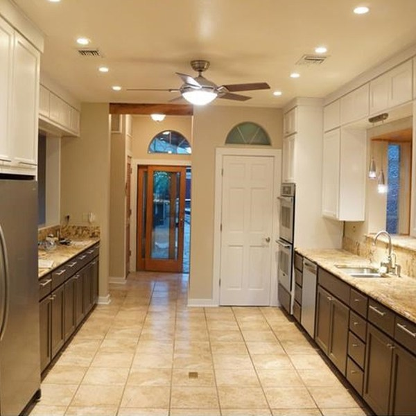 Photo of large beautiful kitchen with granite counter tops and stainless steel appliances