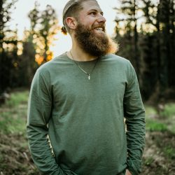 Briggs standing in the woods - briggs beard co