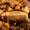 Briggs Beard Co wooden comb in leaves