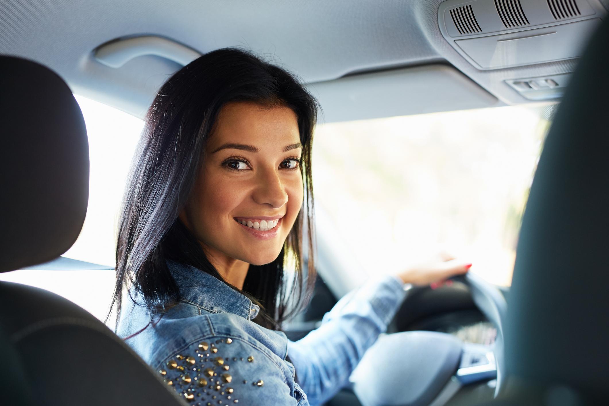 Woman sitting in a car