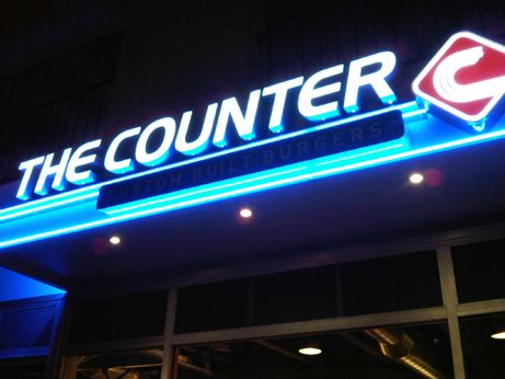 The Counter sign illuminates a welcome glow on Shoppers Lane in Pasadena