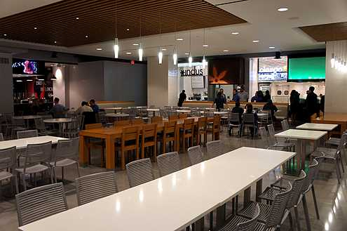 The seating area inside the Taste food court at FIGat7th