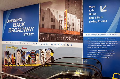 "A large mural in the Ross store informs customers that the city is ""Bringing Back Broadway"""