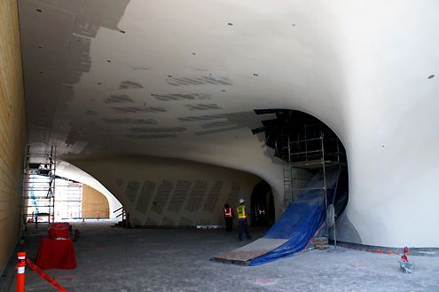 The front entrance area of the museum on the ground level with its curving form