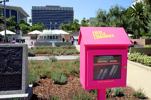 """Take a book, give a book"" as part of Grand Park's free Little Libraries"