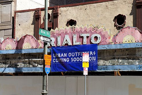 """A closer view of the Urban Outfitters """"coming soooooon"""" sign at the Rialto Theatre on Broadway"""