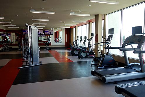 The huge 24 hour fitness center with weights and cardio