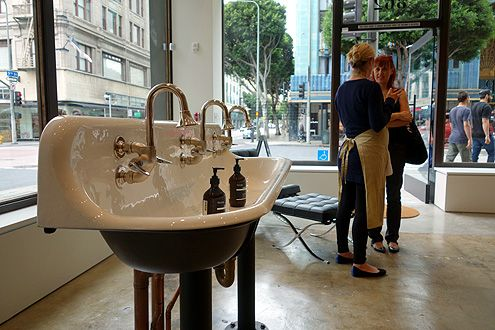"This ""floating"" sink allows customers to try Aesop products in the store"