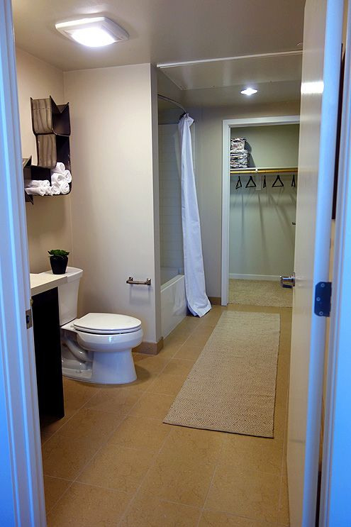 A very large bathroom and walk-in closet in a one bedroom unit