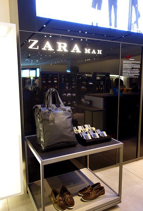 Zara Man cash wrap area with LED screens showing their collections