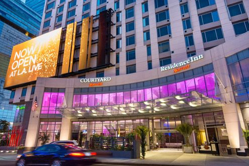 The new double-Marriott-under-one-roof (Courtyard and Residence Inn) in Downtown LA sparkles at night (Photo: Marriott)