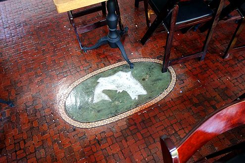The original floors from a former seafood restaurant from the 1950s was restored after removing layers of floor coverings