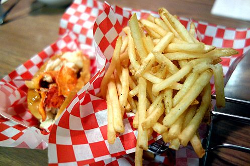 The Lobster Roll served with thin-cut truffle salt fries