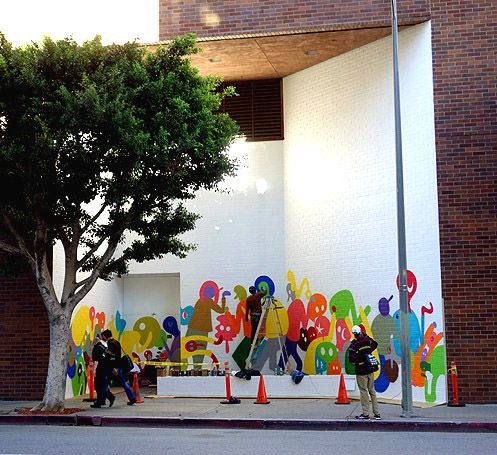 A new mural on the backside of The Bloc by SF-based artist Chris Lux began going up near 8th and Hope on Tuesday, Nov 4