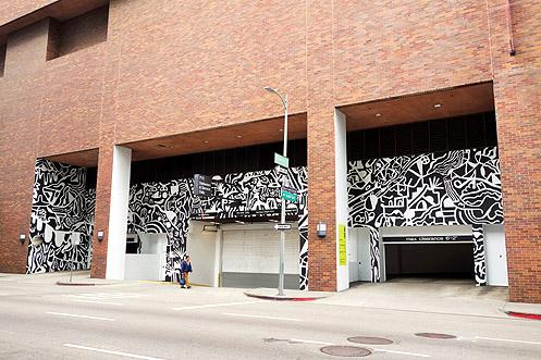 The latest mural by LA-based Sumi Ink Club wraps around the driveways and loading dock area along 8th Street