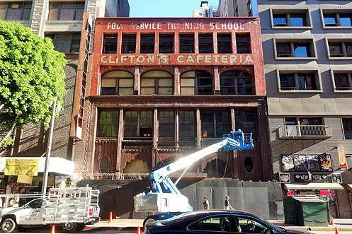 Workers seen this past weekend testing and installing new signage on Clifton's facade