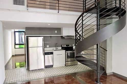 Unit with loft area accessible by spiral staircase