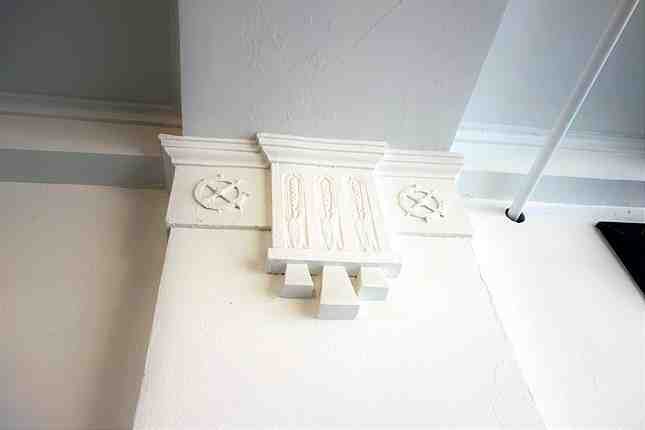"""Wheels and wheat"" make up the design for the column's cornice representing Globe Mills"