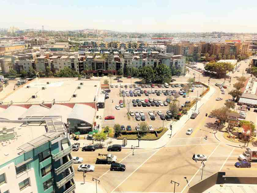 Underutilized property: The 2.2 acre site, with its strip mall and suburban-style parking lot, faces the main pedestrian corridor along 2nd Street that links to the Arts District to the east