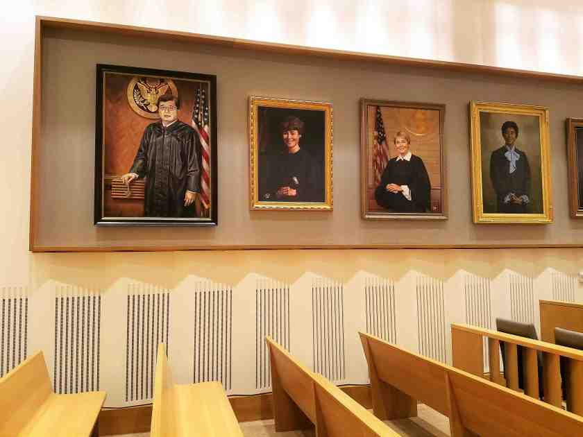 Portraits of federal judges adorn the multi-purpose courtroom