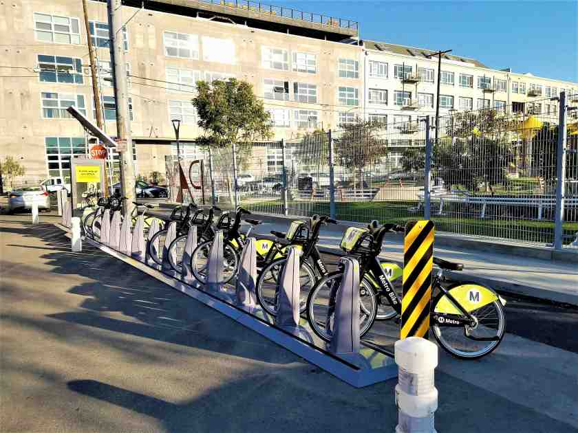 Metro bike share station located conveniently outside park
