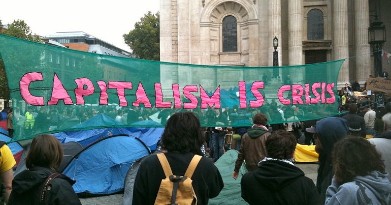 Reclaim the Power banner reading Capitalism is Crisis