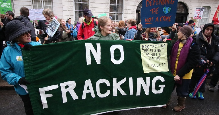 Banner at a protest reading: no fracking