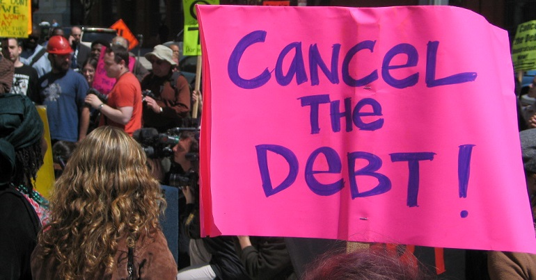 "Protest with a banner reading ""cancel the debt"""