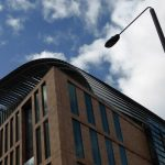 An image of the Francis Crick Institute, cloudy blue sky