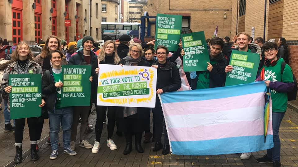 A photo of campaigners at a trans rights march