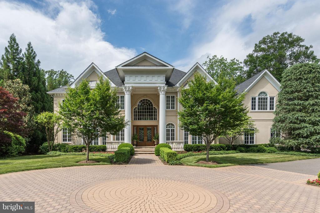 Custom on 1.4 acres in the Reserve. Over 12,000 Sq/Ft. Grand 2-Story Foyer w/ dual staircase. 2-Story Great Room opens to the sprawling Terrace & entertainers dream backyard w/ Pool & outdoor Kitchen. Main Level Master w/ wet bar, his & hers walk-in closets & luxury bath. 7 BRs in Upper Level. Walk-out Lower Level Rec Rm w/ Gym w/ Sauna, Theater, 2nd Kitchen, Wine Cellar & Bedroom w/ Full Bath.