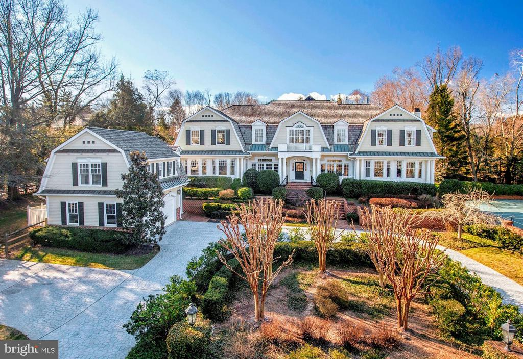 Just Listed! Gorgeous Nantucket-style home on corner lot with Pool and Tennis Court in prime Langley Farms location just moments between Tysons Corner and Washington DC.  Approx 8,300 SF includes Main House and Carriage House - 6/7 BR, 6 Full + 2 Half BAs, 6 Fireplaces, Screened Porch, Walk-Out Lower Level, and more.  Impressive scale and beautiful finishes thruout. Must see!