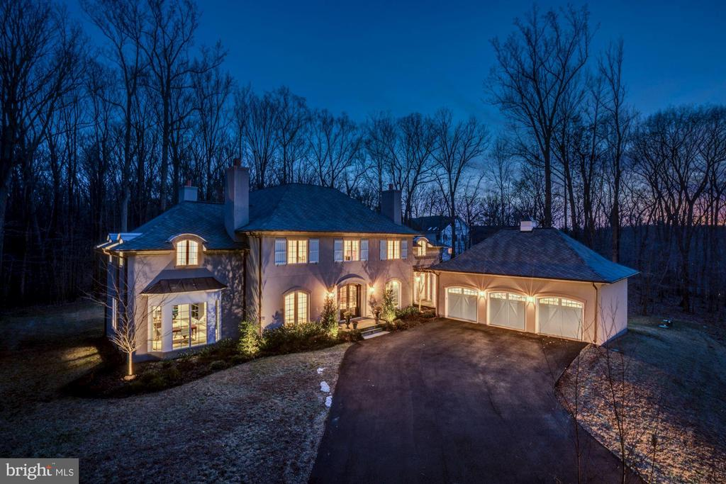 This exquisite residence in McLean is on a unique 2+ acres adjacent to Great Falls Park and sits at end of private street on a cul de sac.  This home provides extraordinary features and parallel craftsman throughout from rich hardwoods to a stunning gourmet kitchen.  Kitchen includes wood beam ceilings and separate breakfast room with stunning views. Master Bedroom has separate his/her baths and his/her closets.  Upper level has family room and spacious ensuite bedrooms with walk in closets.   The basement level has 9ft ceilings, wine room & bar, home theater, recreation room and fitness room.   Easy walk to Great Falls Park trails. This property is zoned for horses.